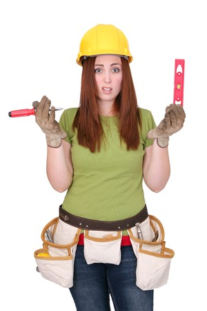 architect tools: one young twenties construction worker female in hardhat looking confused over white