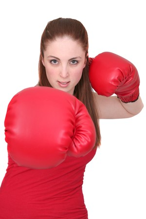 one young girl boxing with big red gloves over white