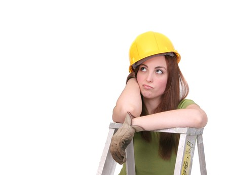 expressive beautiful construction worker woman with hardhat and tools working over white