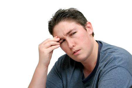 one adult man with a headache or head pain holding his head in worry or anger over white Stock Photo - 4908929