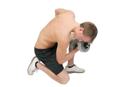 one young fit topless guy lifting weights over white Stock Photo - 4989462