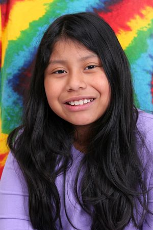 native american girl: one young ethnic mayan girl with long black hair over a very colorful background