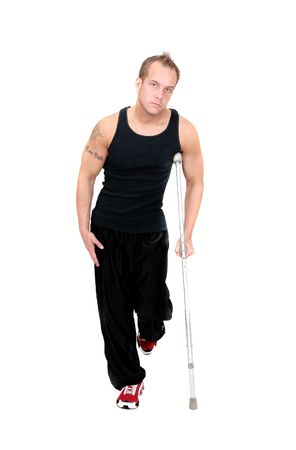 one adult man walking on crutches over white photo