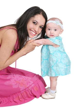 one young dark haired mother in pink and her young baby girl child Stock Photo - 5016436