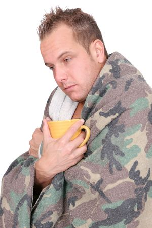 one sick adult man holding a mug wrapped in a blanket over white Stock Photo - 5022454