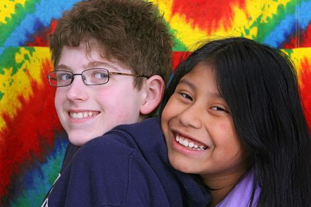 two young kids over a rainbow colorful background photo