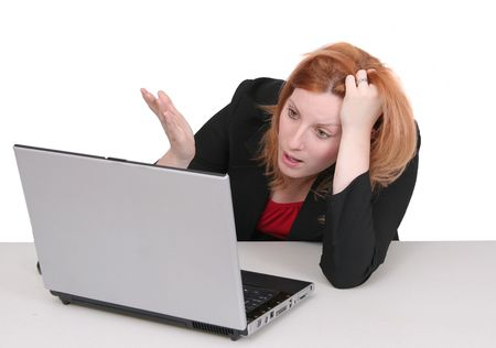 one young adult red haired business lady in black and red over white frustrated with her computer