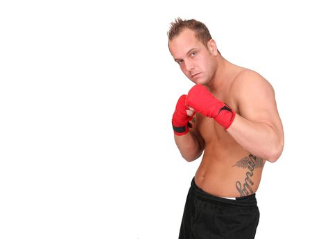 Bare-chested boxer with wrapped hands poses for the camera. Horizontal format. photo