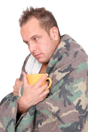 one sick adult man holding a mug wrapped in a blanket over white Stock Photo - 6309380