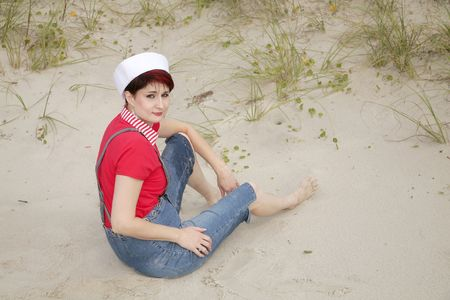 one adult female model posing in sailor wear at the beach photo