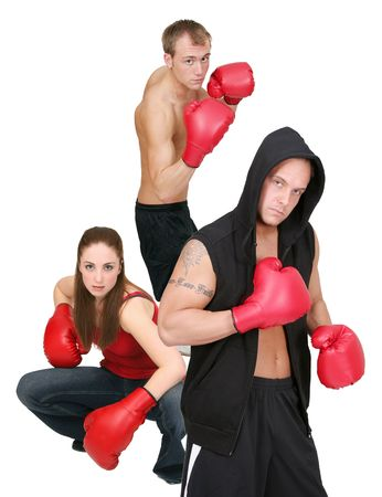 three young adult boxers in their twenties with red gloves isolated over white Stock Photo - 6505800