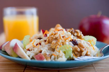 one plate of apple walnut salad similar to Waldorf Salad on a blue plate with a glass of orange juice Banque d'images
