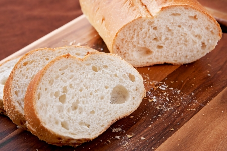 loaf of thick slice Italian bread on a cutting board. closeup horizontal format.