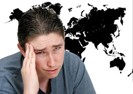 a man with a headache thinking about the worlds problems in front of a black map on white photo