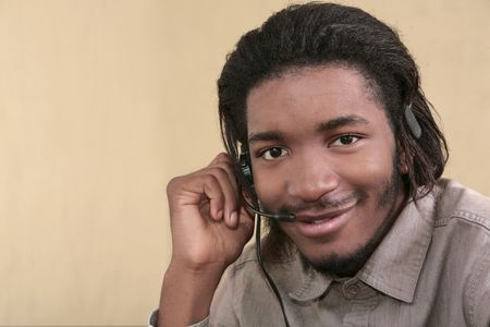 one twenties African American male business worker talking on a headset Stock Photo