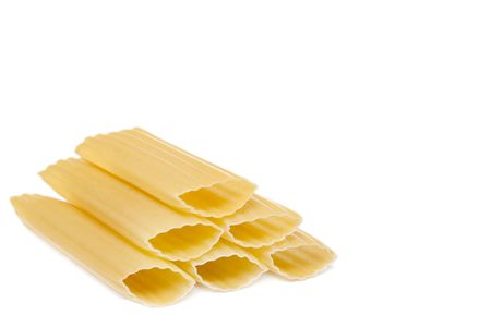 one stack of 6 uncooked manicotti pasta shells over white with shadow still included photo