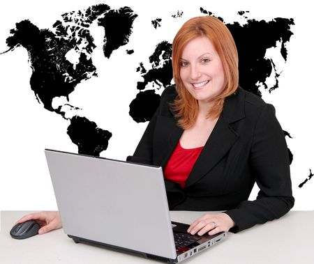 one redhead attractive young businesswoman working on a laptop with full map of the Earth behind her in black Banque d'images