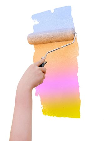 caucasian man's hand on a very colorful impossible paint roller over a white blank wall Banque d'images