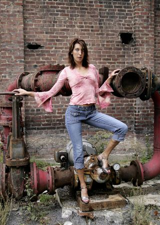 one adult woman standing outdoors against a grungy city background photo