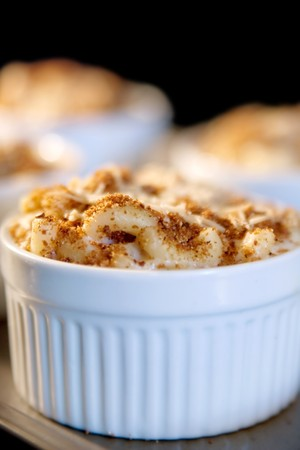 homemade macaroni and cheese baking in the oven inside a ramekin photo