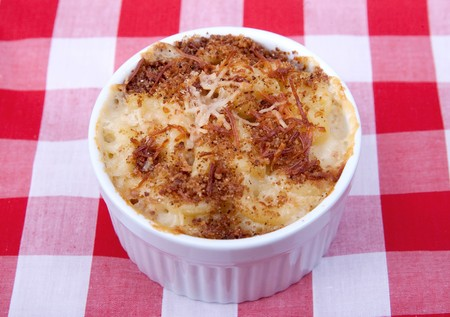 bowl of homemade mac and cheese on a red and white checkered background Stock Photo - 7440113