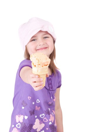one young girl child with a big smile holding an ice cream cone toward the viewer