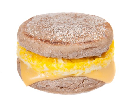one full size egg muffin with melted cheese on an English muffin
