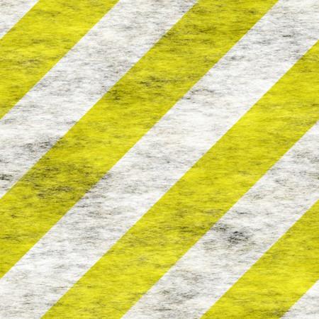 hazard stripes: grungy yellow and white stripes. tiles seamlessly