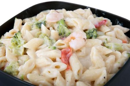 pesto shrimp pasta in a black bowl  photo