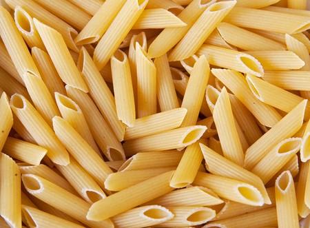macro closeup of penne pasta background texture Archivio Fotografico