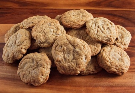 small batch of gluten free chocolate chip cookies on a wooden cutting board Stock Photo - 7527060
