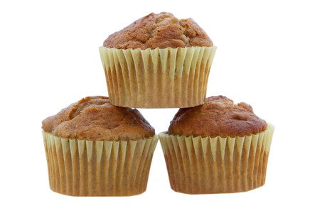 three banana muffins stacked and isolated over white photo