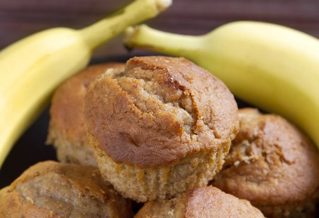 stack of banana muffins on a black plate closeup Stock Photo - 7749724