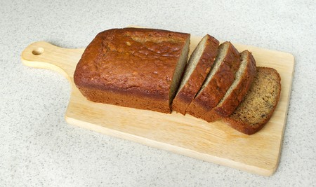 closeup of banana bread on a cutting board in the kitchen
