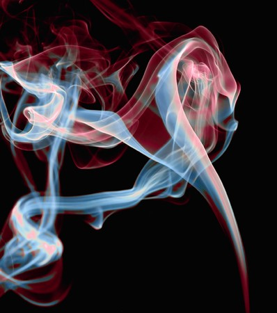 abstract rainbow colored smoke on a black background