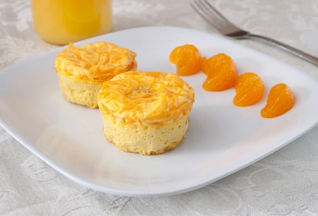 plate of breakfast egg and broccoli muffins with cheese on a white plate photo