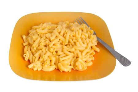 macaroni and cheese dinner on a yellow plate isolated over white