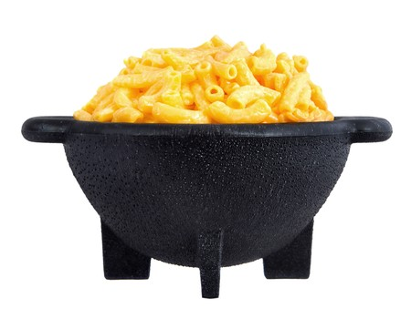 macaroni and cheese: macaroni and cheese dinner on a yellow plate isolated over white