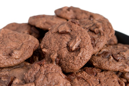 closeup pile of double chocolate chip cookies over white Stock Photo - 8648638