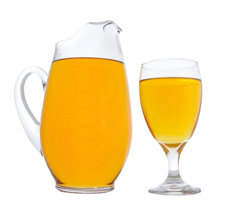 pitcher and glass of apple juice over white