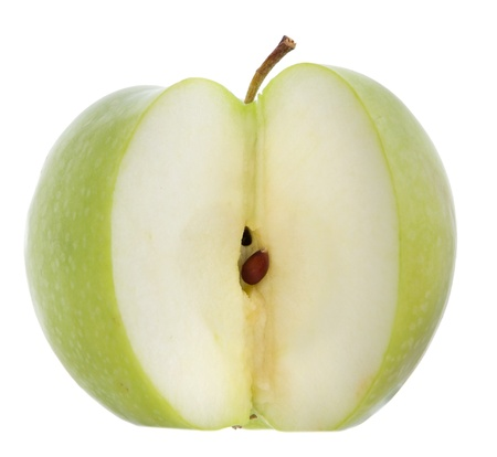 one green apple with a slice removed to see the core