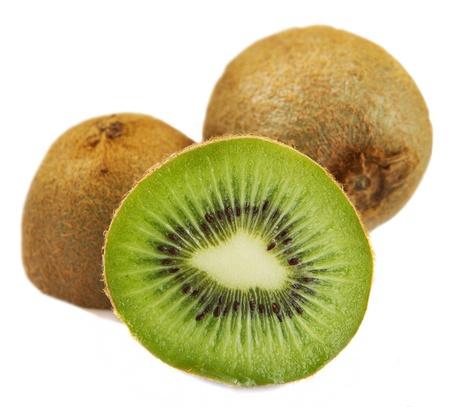sliced kiwi fruits over a white background showing inside Banque d'images