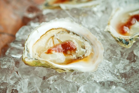 half shell of oyster with cocktail sauce
