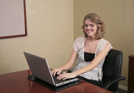 twenties blonde professional typing on a laptop computer