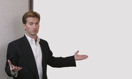 confused or stressed business man throwing hands up in front of a white board