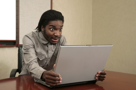 very unhappy or stressed business guy looking at a laptop