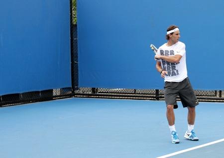 atp: MELBOURNE, AUSTRALIA - JANUARY 21, 2012: ATP world number 2 tennis player Rafael Nadal hits on a practice court January 21, 2012 in Melbourne, Australia. Nadal lost in the final to Novak Djokovic 7-5, 4-5, 2-6, 7-6 (7-5), 5-7 .