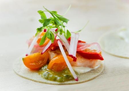seared salmon taquito wrap on a cutting board