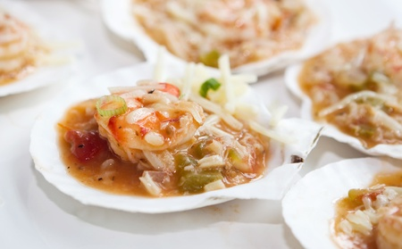 half fish: seafood jambalaya with shrimp, scallops, oyster and lobster meat Stock Photo