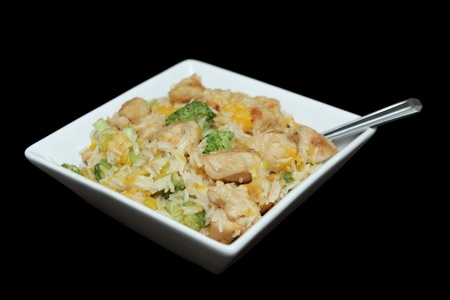 close up bowl of ginger orange chicken with broccoli and soy sauce Stock Photo - 12749934